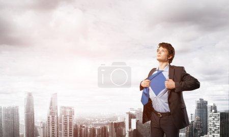 Office worker opening shirt