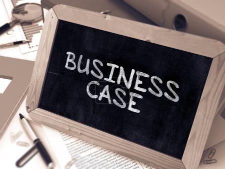 Business Case Handwritten by White Chalk on a Blackboard.