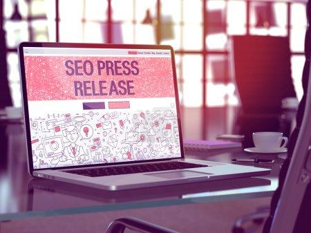 Seo Press Release on Laptop in Modern Workplace Background.