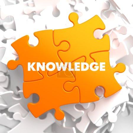 Photo for Knowledge on Orange Puzzle on White Background. - Royalty Free Image