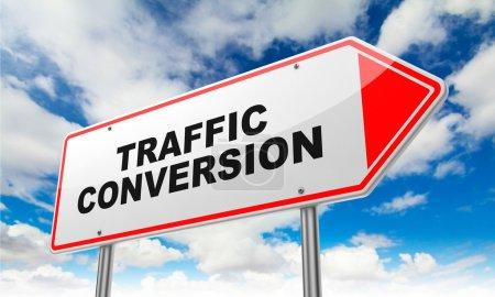Photo pour Traffic Conversion - Inscription on Red Road Sign on Sky Background. - image libre de droit