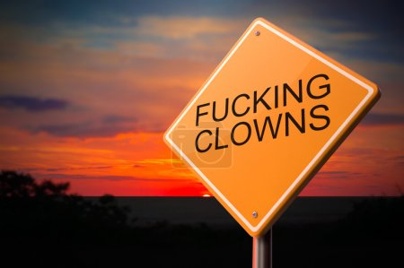 Photo for Fucking Clowns on Warning Road Sign on Sunset Sky Background. - Royalty Free Image