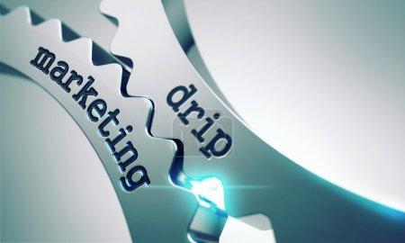 Photo pour Concept de commercialisation goutte à goutte sur le mécanisme des roues dentées en métal . - image libre de droit