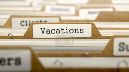 Vacations Concept with Word on Folder.