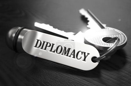 Photo for Diplomacy Concept. Keys with Keyring on Black Wooden Table. Closeup View, Selective Focus, 3D Render. Black and White Image - Royalty Free Image