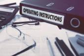 Operating Instructions on Office Folder. Toned Image.