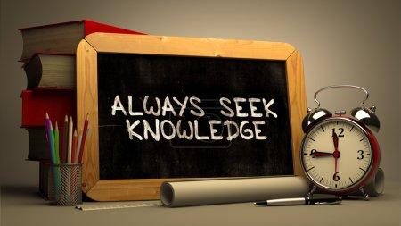 Handwritten Always Seek Knowledge on a Chalkboard.