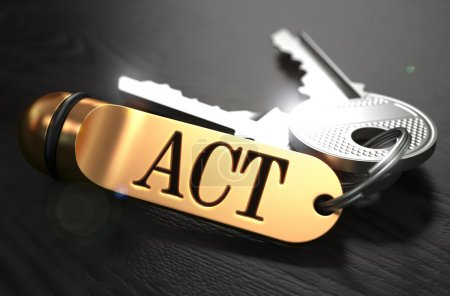 Act - Bunch of Keys with Text on Golden Keychain.
