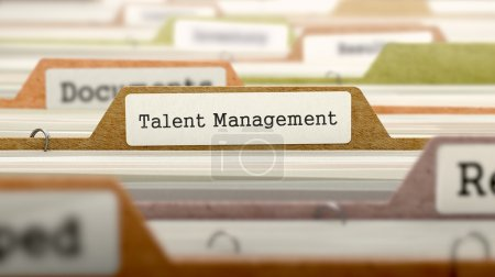 Photo for File Folder Labeled as Talent Management in Multicolor Archive. Closeup View. Blurred Image - Royalty Free Image