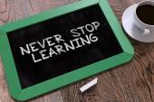 Never Stop Learning - Motivation Quote on Chalkboard.