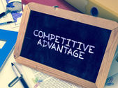 Hand Drawn Competitive Advantage Concept on Small Chalkboard.
