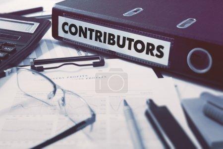 Office folder with inscription Contributors.