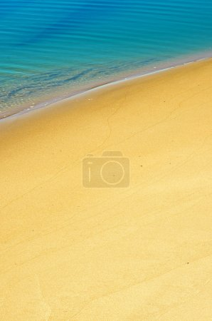 Photo for Serene sea shore closeup with calm water over sand - Royalty Free Image