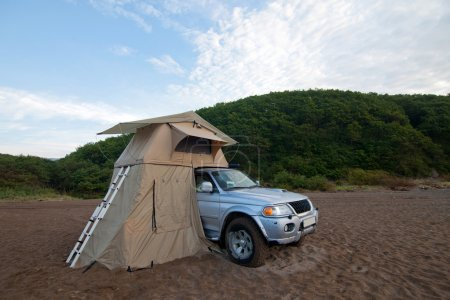 Car with rooftop tent on it