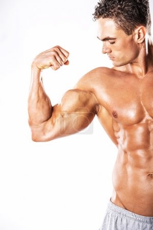 Man showing muscular strained biceps
