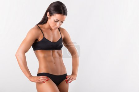 Beautiful sporty woman body. Isolated on white background