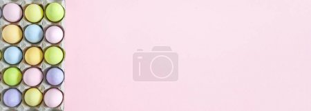Photo for Colorful Pastel Easter eggs on pink background, top view with natural light. Flat lay style. - Royalty Free Image
