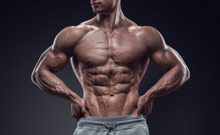 Photo for Handsome power athletic young man with great physique. Strong bodybuilder with six pack, perfect abs, shoulders, biceps, triceps and chest. Image have clipping path - Royalty Free Image