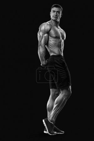 Strong and handsome young bodybuilder demonstrate his muscular torso