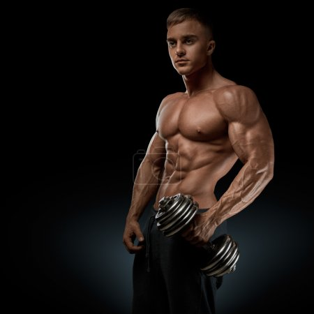 Strong and power bodybuilder doing exercises with dumbbell