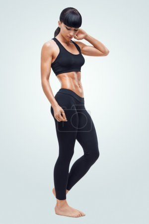 Fitness sporty woman showing her well trained body