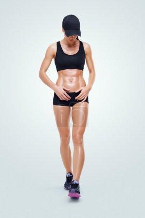 Fitness sporty woman walking after workout