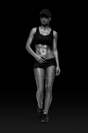 Photo for Fitness sporty woman walking on black background. Strong abs showing. - Royalty Free Image
