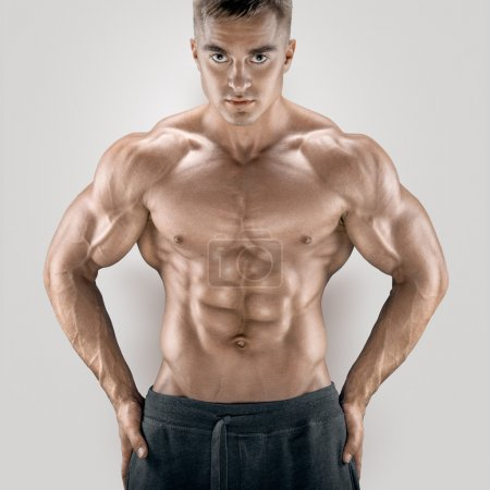 Handsome and young power athletic man with great physique