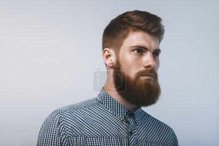 Photo for Bearded man confidently looking forward. Studio shot on white background - Royalty Free Image