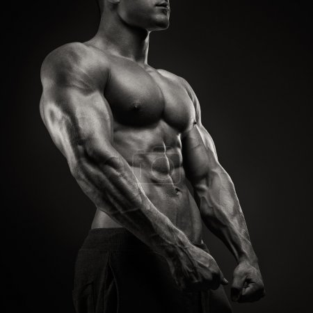 Strong and power bodybuilder posing