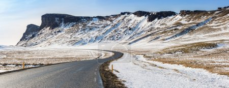 Winter Mountain range road in a sunny day at Vik, ...