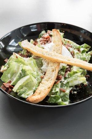 Photo for Bowl of green caesar salad - Royalty Free Image