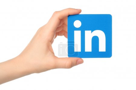 Photo for KIEV, UKRAINE - MARCH 7, 2015:Hand holds Linkedin logo sign printed on paper on white background. Linkedin is a business social networking service. - Royalty Free Image