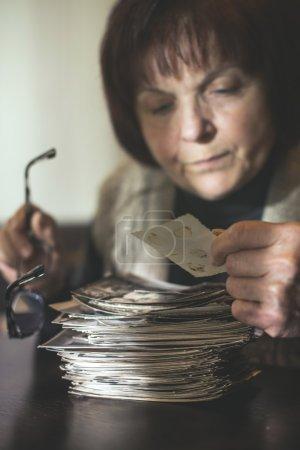 Senior woman watching old photos