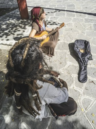 Street musicians playing guitar