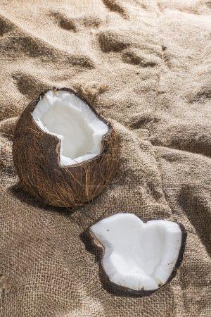 cracked coconut on burlap