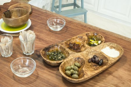 Olives in a wooden bowl