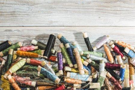 Spools of thread on white wood