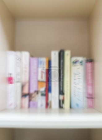 Blurred books on bookshelf