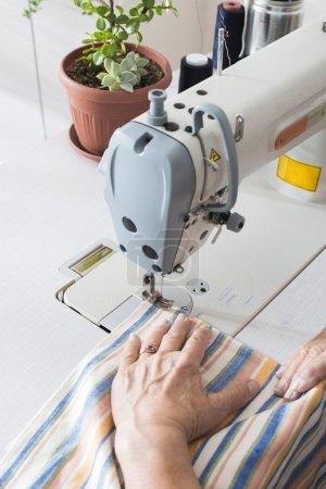 Woman sew on sewing machine