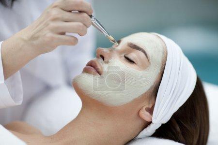 Woman making cosmetic procedures