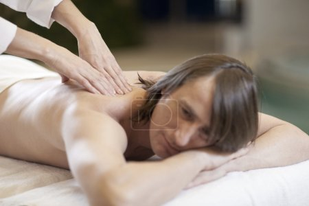 Man receiving massage relax treatment close-up from female hands