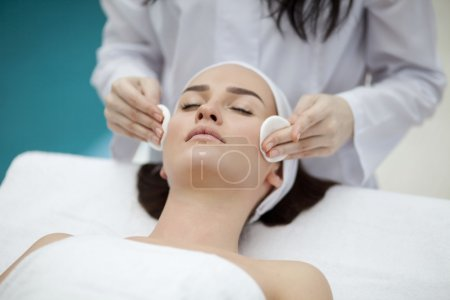 Woman making cosmetic procedures