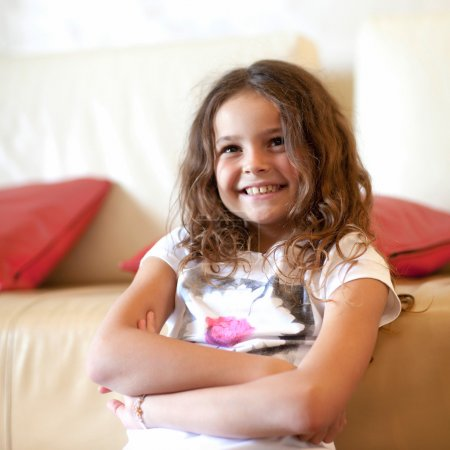 Photo for Little girl smiles at the camera. - Royalty Free Image