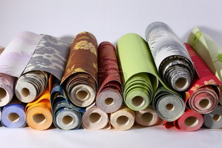 Photo for Colorful rolls of Wallpaper are on the table - Royalty Free Image