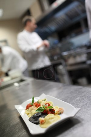 Photo for Chef preparing food in kitchen - Royalty Free Image