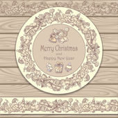 Circle frame and border from Christmas  elements on wood background in beige