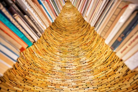 Lots of books stacked in layers in huge wall