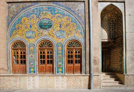 Tiled walls and wooden doors of the royal palace Golestan in Tehran, Iran.