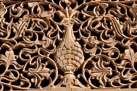 Tree of life, tangled branches and leaves carved o...